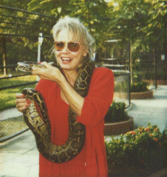 In Thailand, she was asked if she would like to experience the feeling of a live snake.